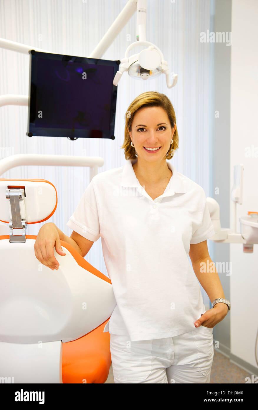 Portrait of female dentist in clinic - Stock Image