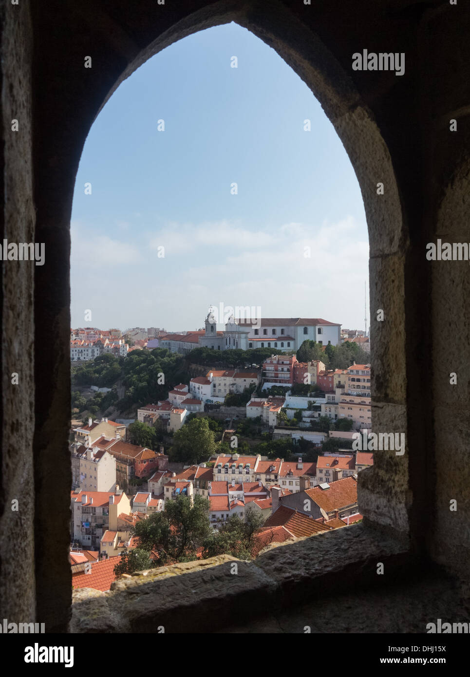 Old houses and roofs of the Alfama district of Lisbon in Portugal. Taken from Castle of Sao Jorge or St George. - Stock Image
