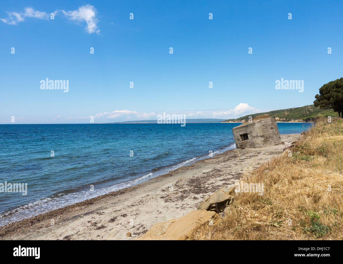 Old concrete WW1 bunker or pillbox on the beach at Anzac Cove in Gallipoli, East Thrace, Turkey - Stock Image