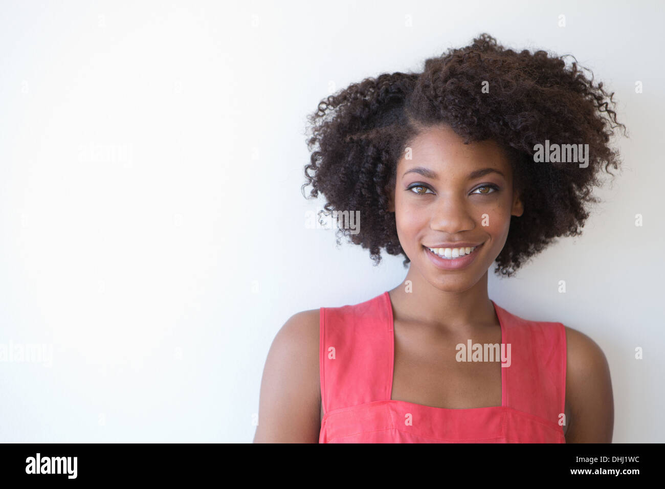 Portrait of young woman against white background Stock Photo