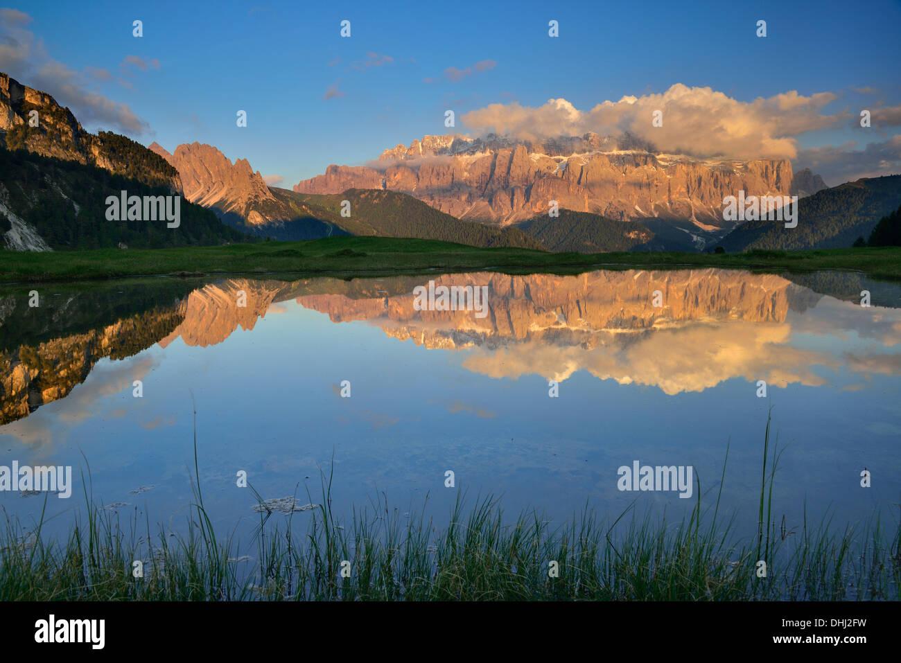Sella range reflecting in a mountain lake, Val Gardena, Dolomites, UNESCO world heritage site Dolomites, South Tyrol, Stock Photo