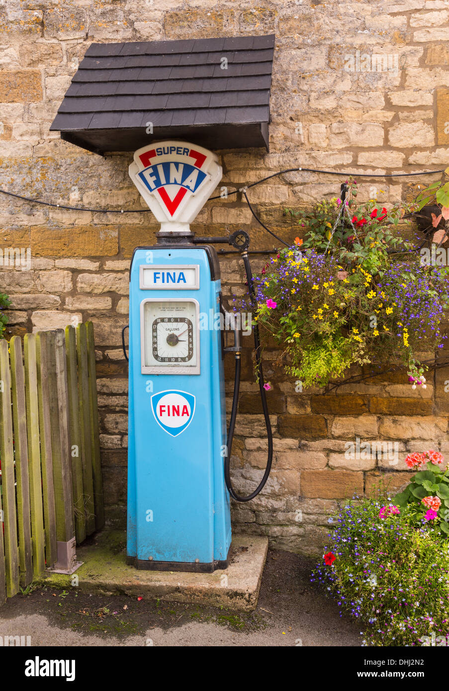 Fina Petrol pump from the 1950s at Plough Inn near Stanway in the Cotswolds, UK - Stock Image