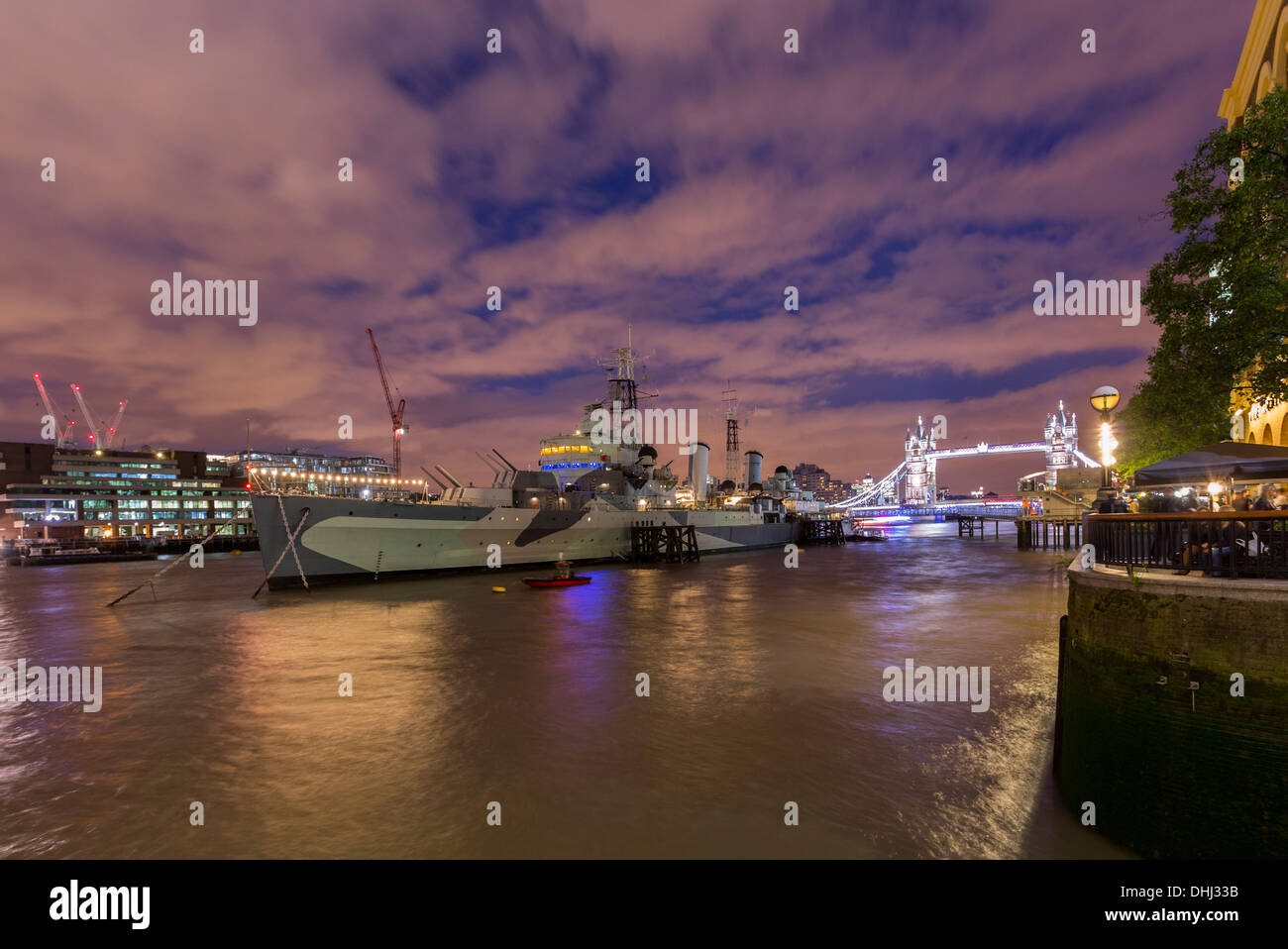 Night shot of the River Thames, HMS Belfast, Tower Bridge in early dusk - Stock Image