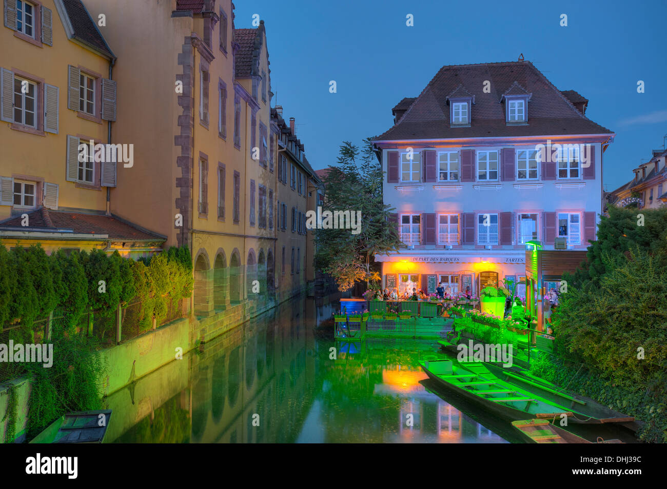 Museum of natural sciences at the Lauch river in the evening, Little Venice, Colmar, Alsace, France, Europe - Stock Image