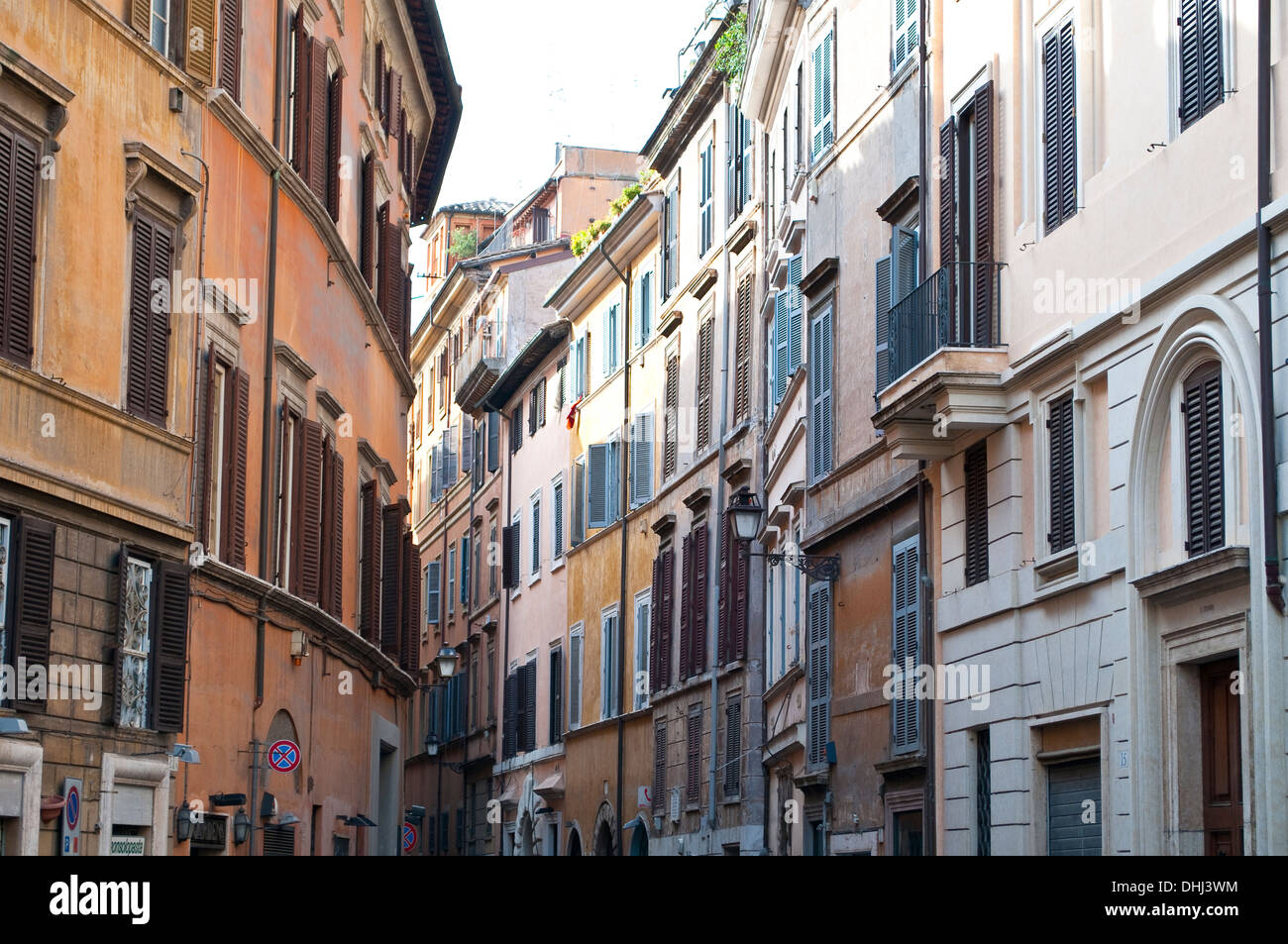 Tall houses in a narrow street near Piazza in Campo Marzio, Rome, Italy - Stock Image