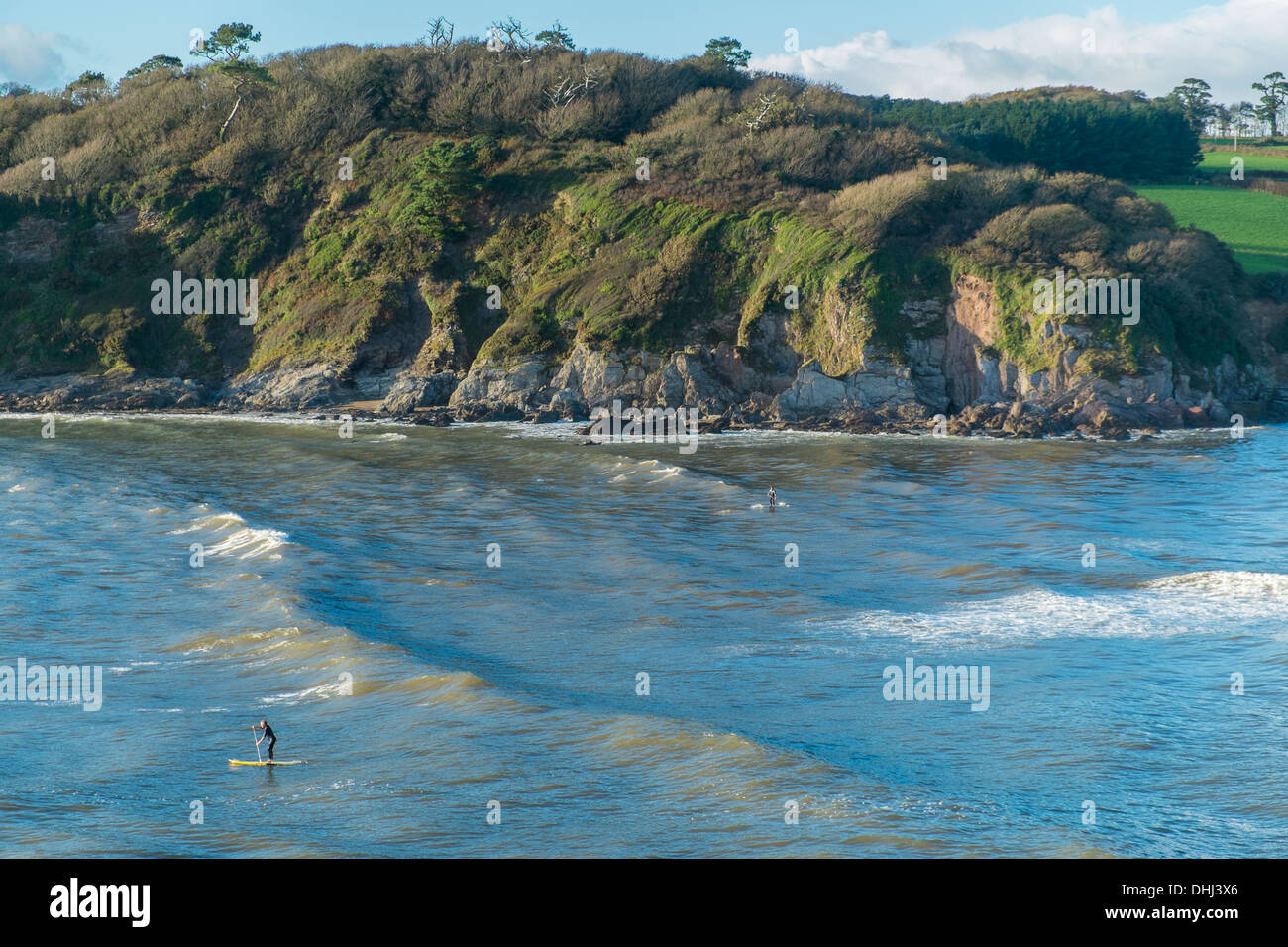 Stand up paddle boarders in the mouth of the River Erme, South Hams. Devon. UK - Stock Image