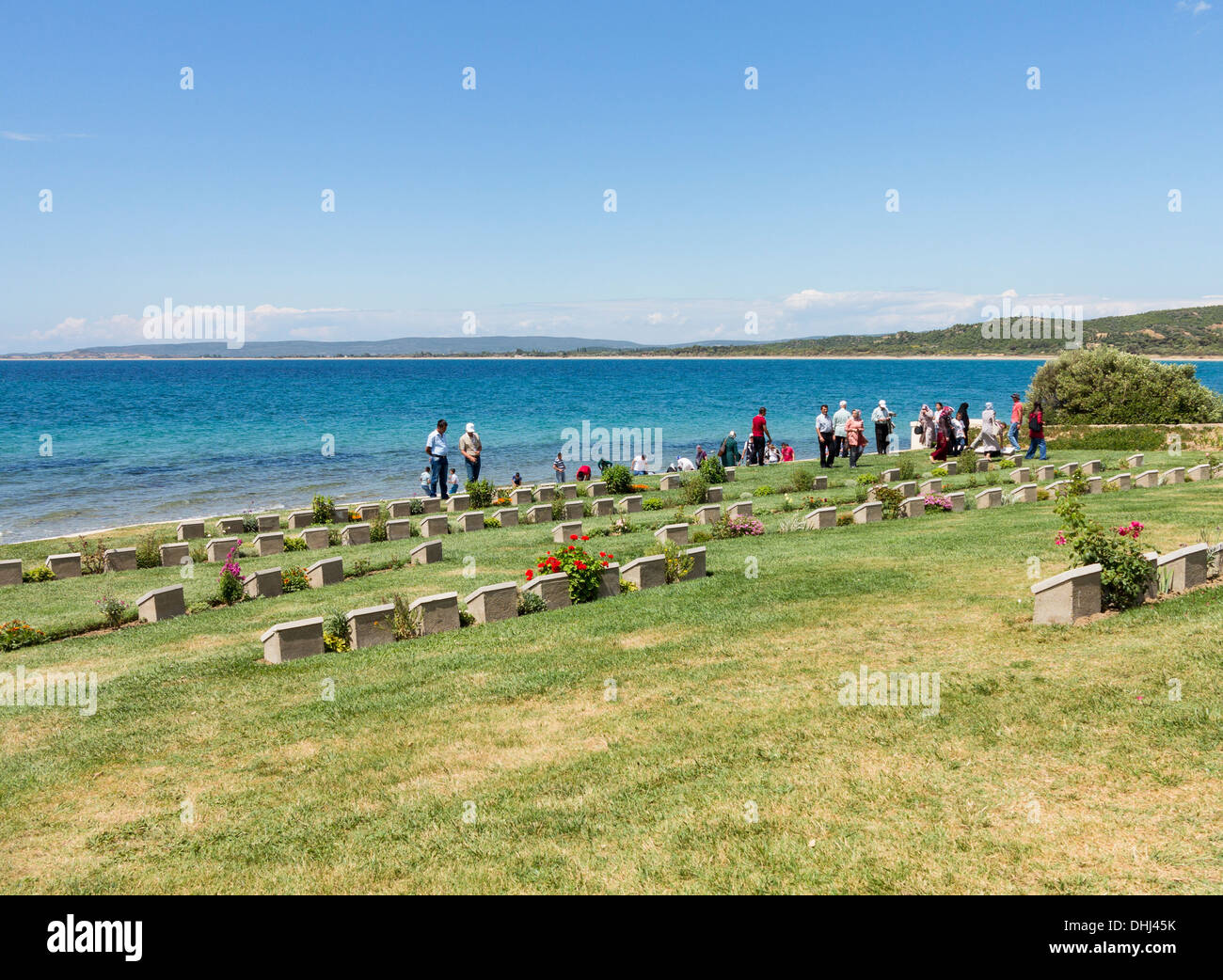 People at the the WW1 Gallipoli campaign war cemetery at Anzac Cove, Turkey - Stock Image