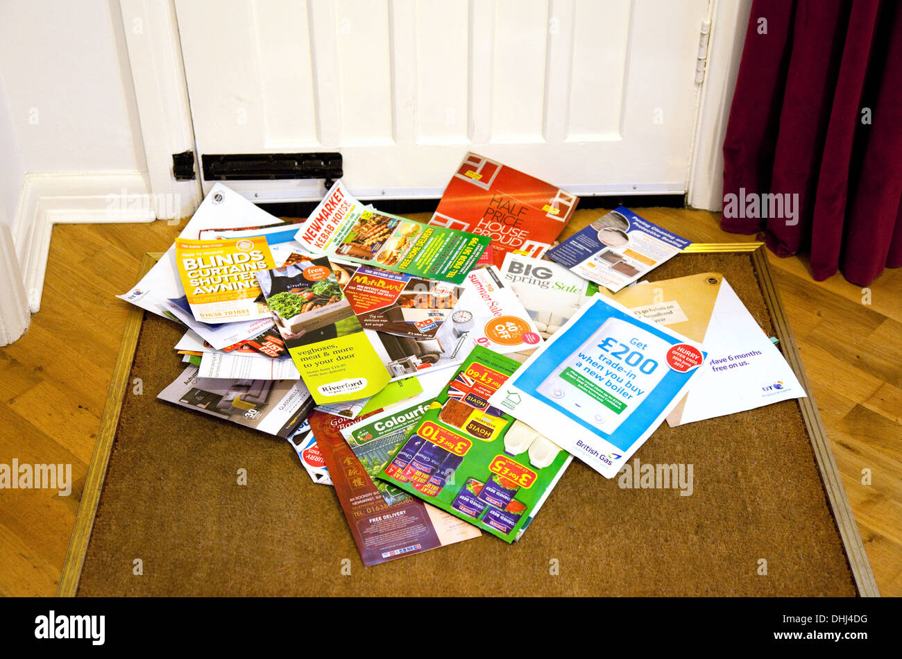 Junk mail on the doormat in a home, England UK - Stock Image