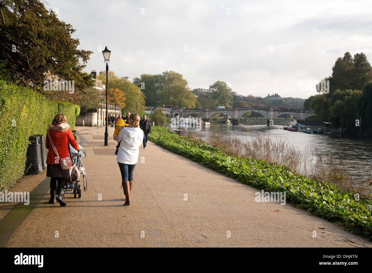 The Thames path at Richmond, London England - family walking on an autumn morning - Stock Image