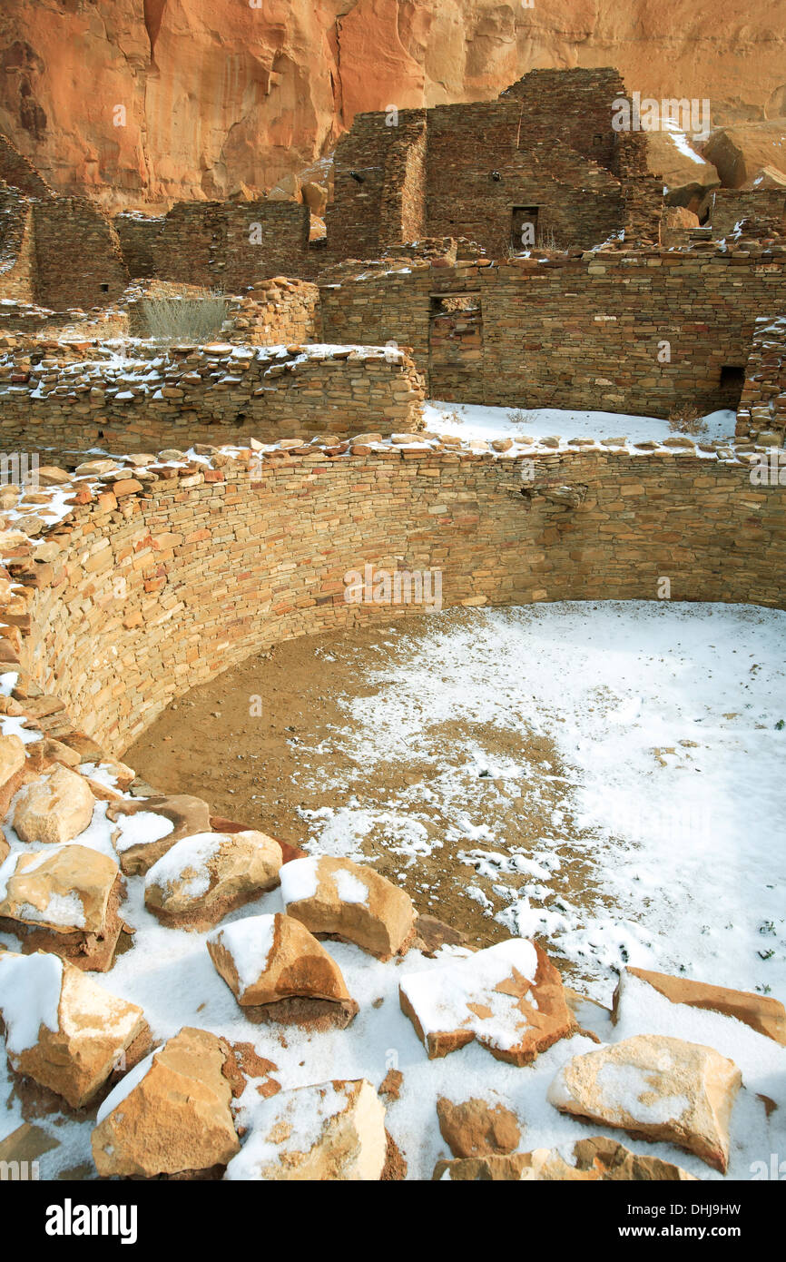 Kiva (ceremonial chamber) and buildings under snow, Pueblo Bonito great house, Chaco Culture National Historical Stock Photo
