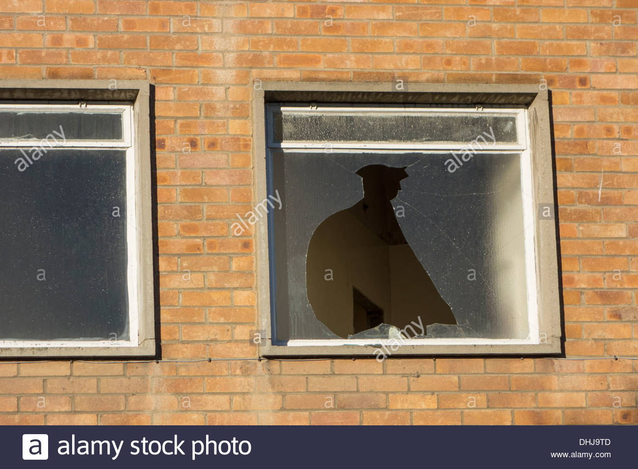 Broken window in a building that is being demolished in Huntingdon, Cambridgeshire - Stock Image