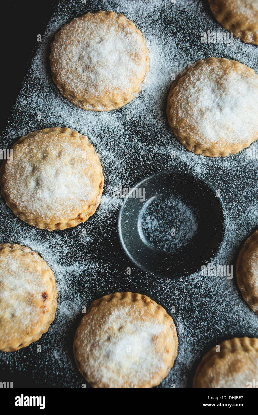 Mince pies freshly cooked still in tin - Stock Image