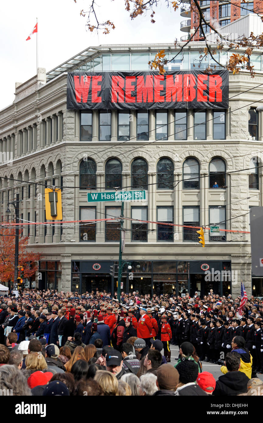 Soldiers, army cadets, and members of the Royal Canadian Mounted Police gather at Remembrance Day ceremonies in Victory Square in downtown Vancouver, British Columbia, Canada - Stock Image