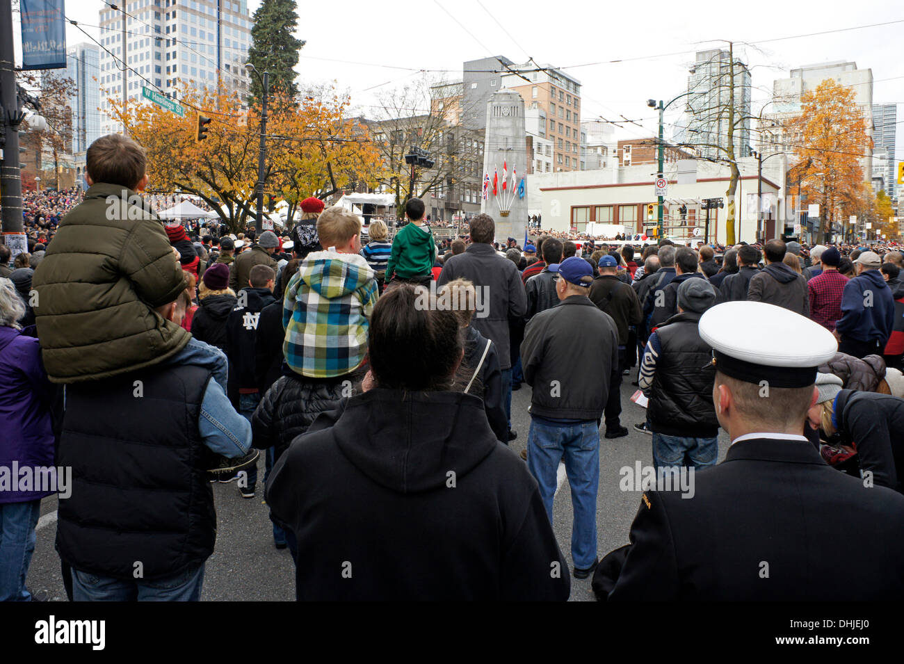 Crowds of people attend Remembrance Day ceremonies in Victory Square in downtown Vancouver, British Columbia, Canada - Stock Image