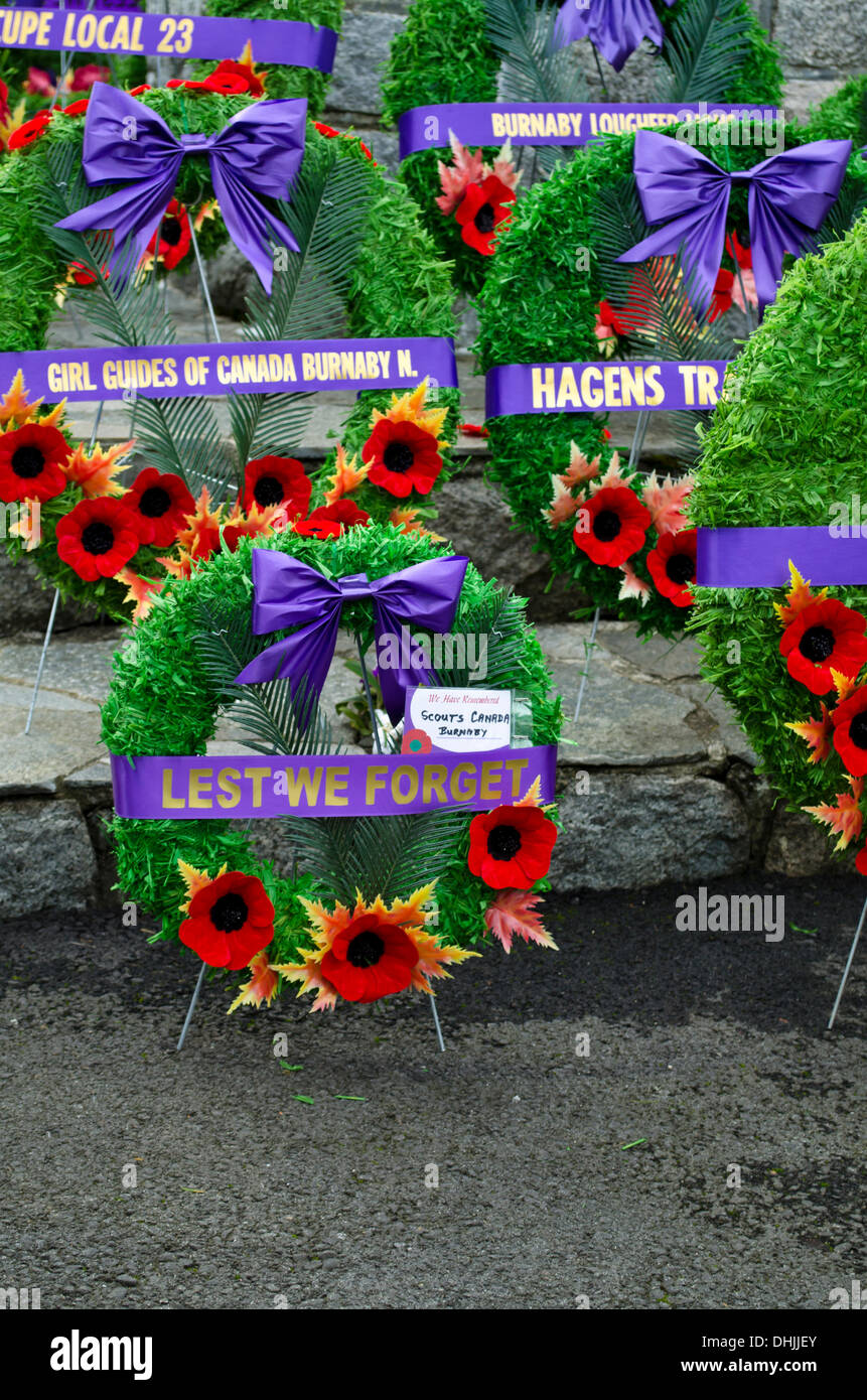 BURNABY, BRITISH COLUMBIA, CANADA – Monday November 11, 2013:  Remembrance Day wreaths and poppies displayed on the centotaph in Confederation Park. - Stock Image