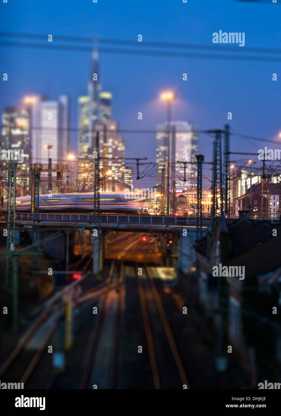 Germany, Hesse, Frankfurt, Tilt-shift view of central station with financial district in background - Stock Image