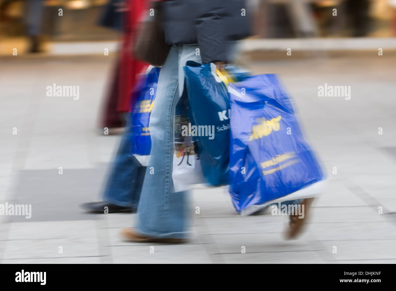 Germany, Hesse, Frankfurt, two persons with Christmas purchases - Stock Image