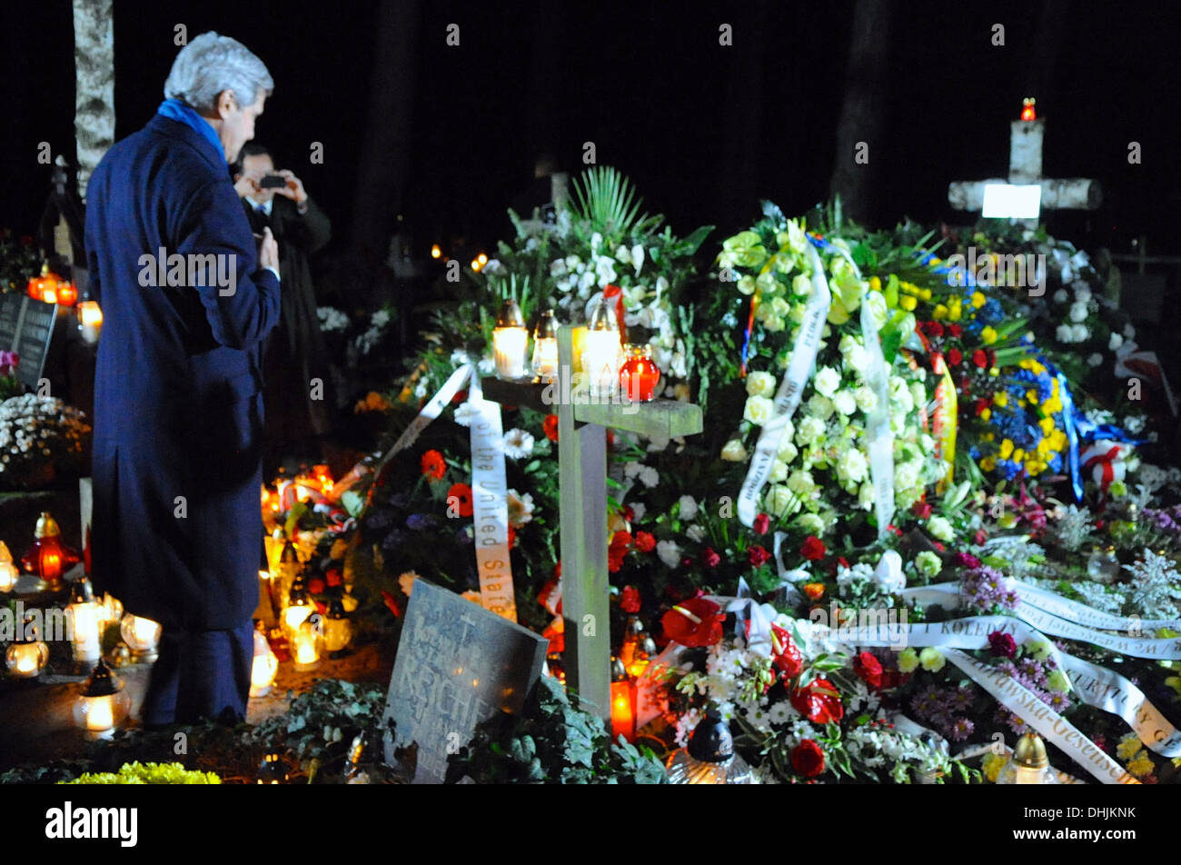 Secretary Kerry Pays Respects at Gravesite of Former Polish Prime Minister Mazowiecki Stock Photo