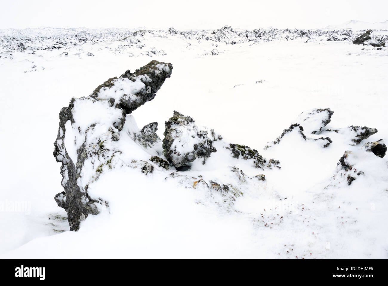 Volcanic landscape with lava field and snow covered. - Stock Image