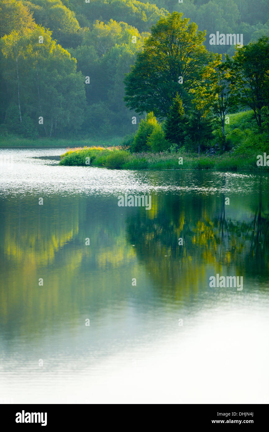 Serene lake coastline picturesque peaceful tranquility Stock Photo
