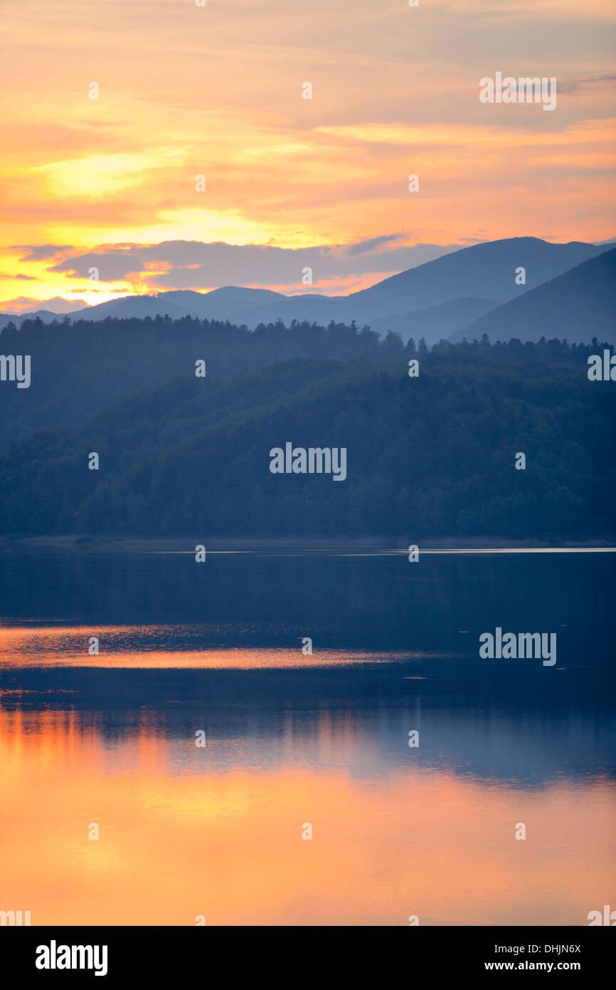 Sunset above lake backgrounds background Stock Photo