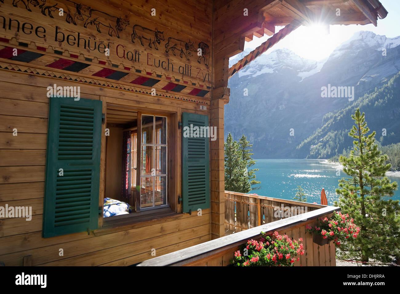 Chalet at lake Oeschinensee, Kandersteg, Bernese Oberland, Canton of Bern, Switzerland, Europe - Stock Image