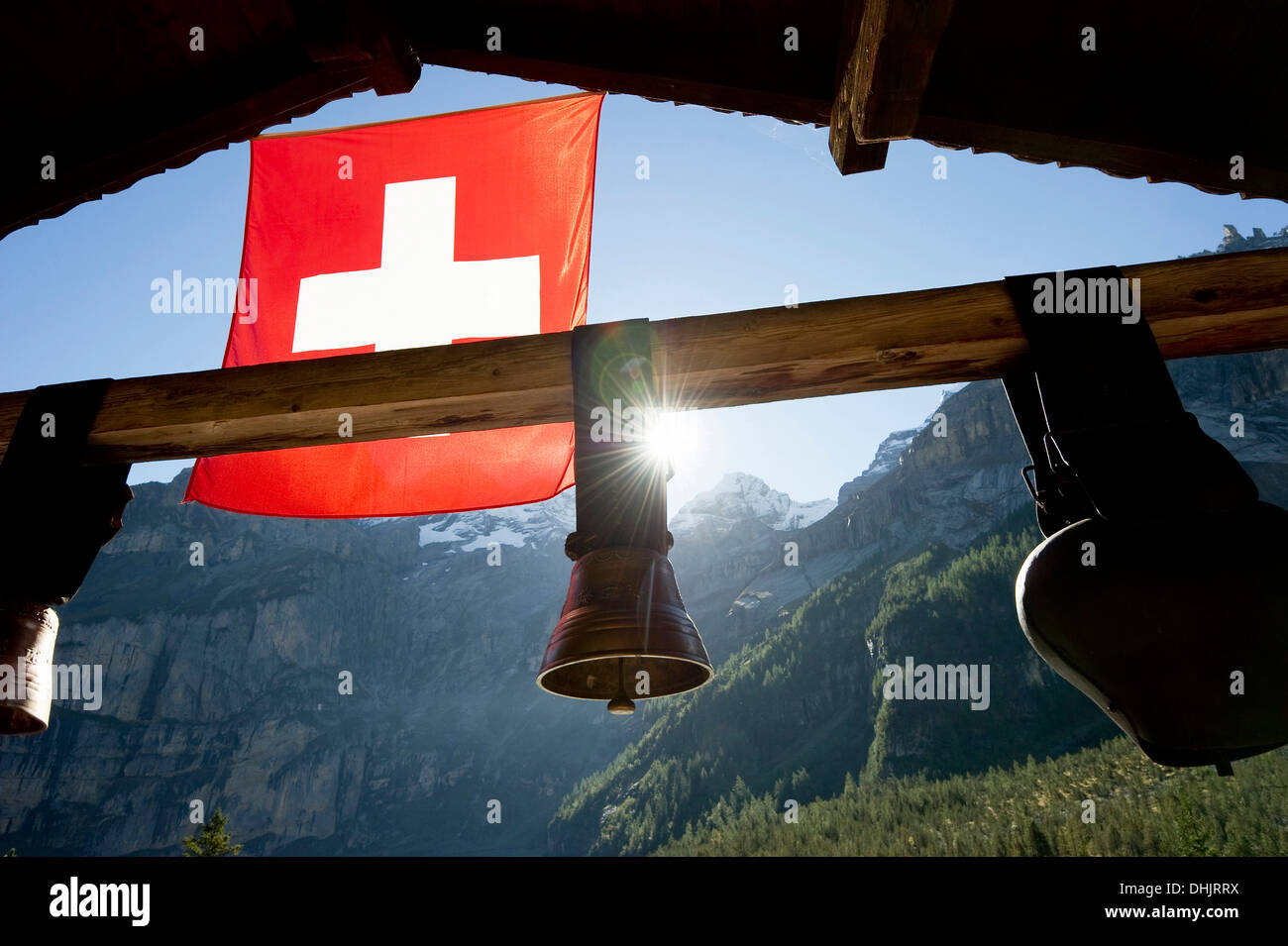Swiss flag and cow bells at lake Oeschinensee, Kandersteg, Bernese Oberland, Canton of Bern, Switzerland, Europe - Stock Image
