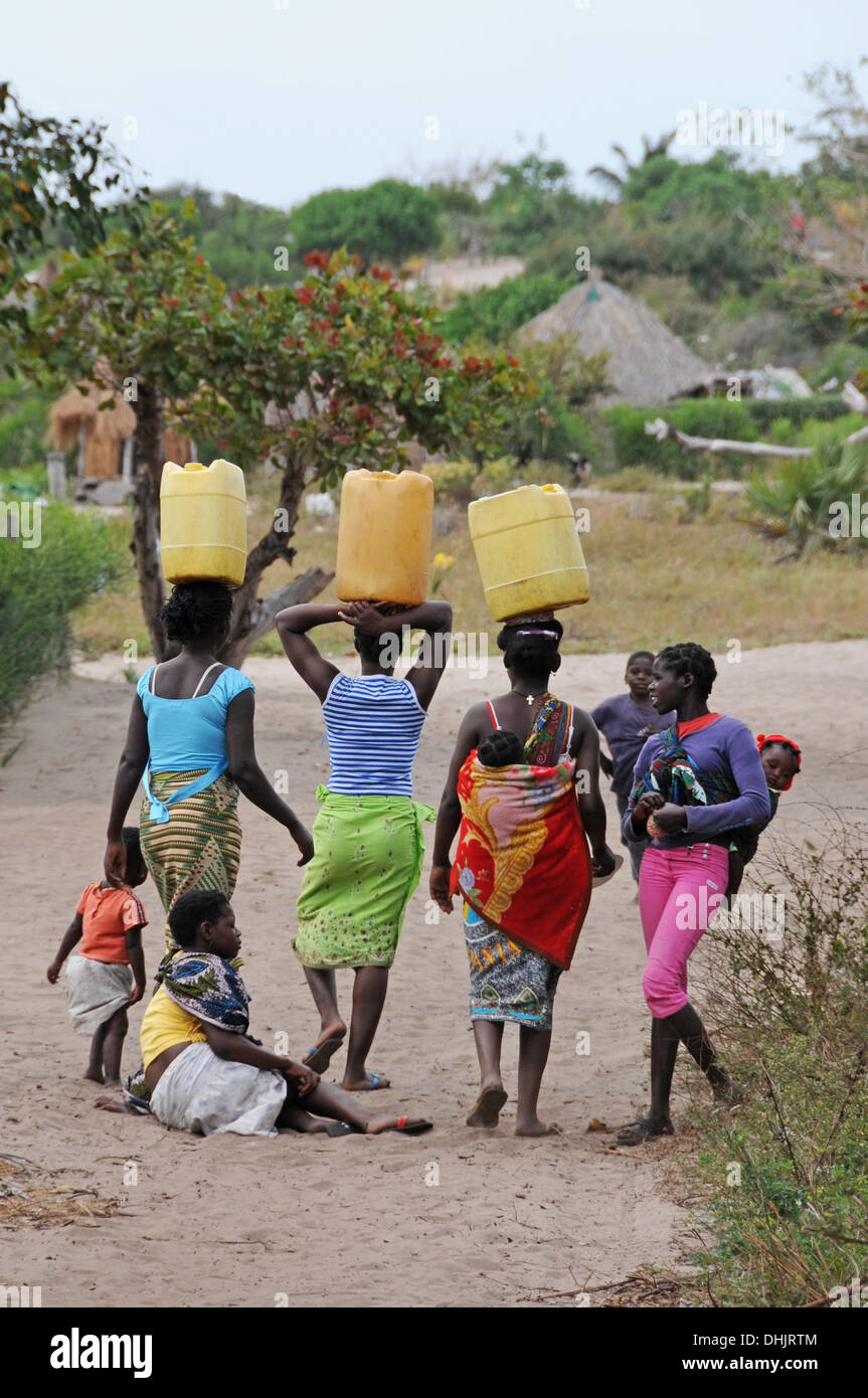 Village women fetching water. Benguerra Island, Bazaruto Archipelago. Mozambique. East Africa. - Stock Image