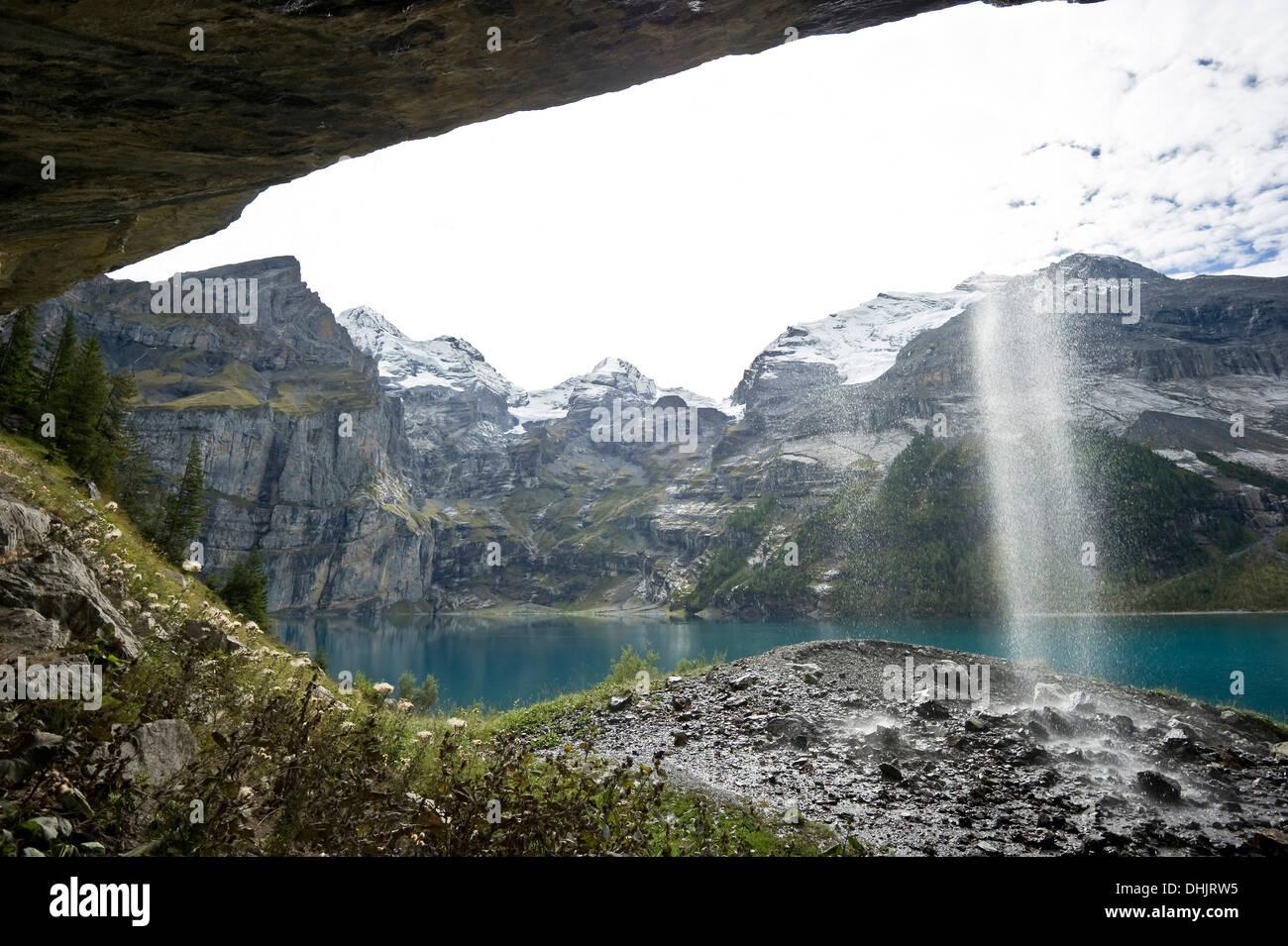 cascade and sun, Oeschinen Lake, Kandersteg, Bernese Oberland, Canton of Bern, Switzerland, Europe - Stock Image