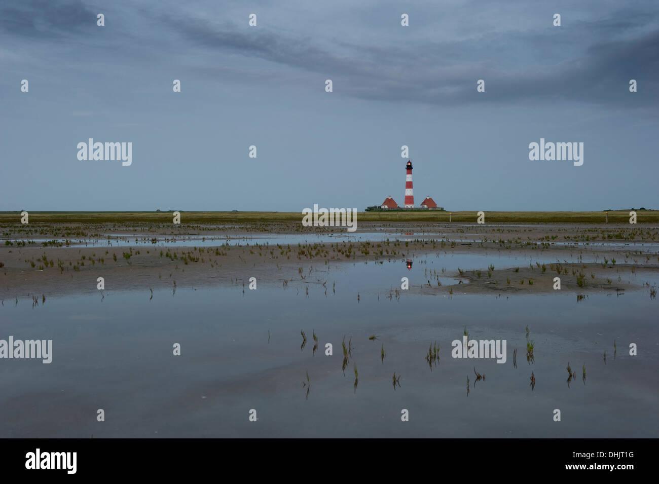 View over mudflats onto Westerheversand lighthouse, Westerhever, Wadden Sea National Park, Eiderstedt peninsula, North Frisian I - Stock Image