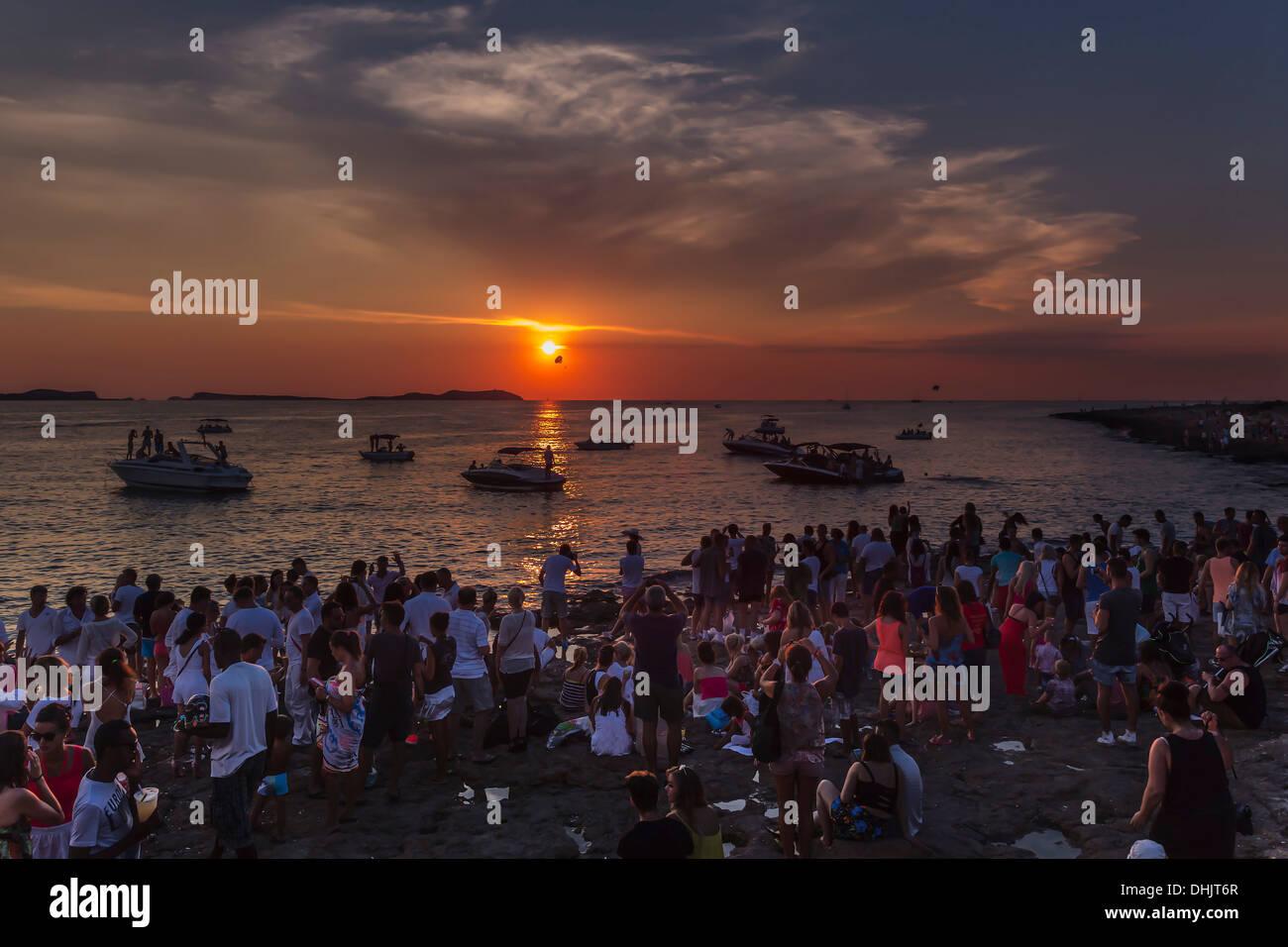 Spain, Balearic Islands, Ibiza, Sant Antoni, people watching sunset at Cafe del Mar - Stock Image