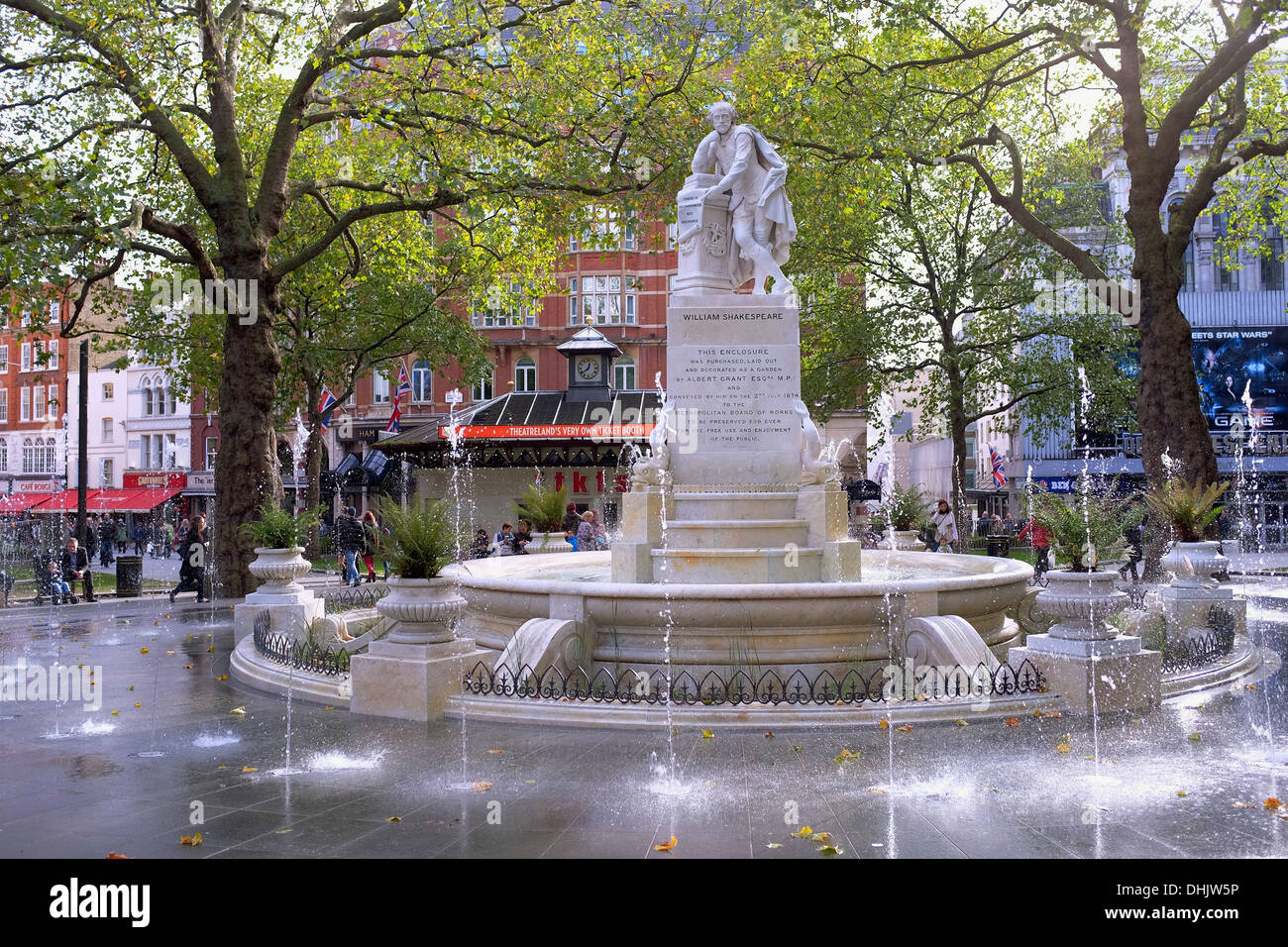 Marble fountain in Leicester Square Gardens with statue of William Shakespeare, London UK - Stock Image