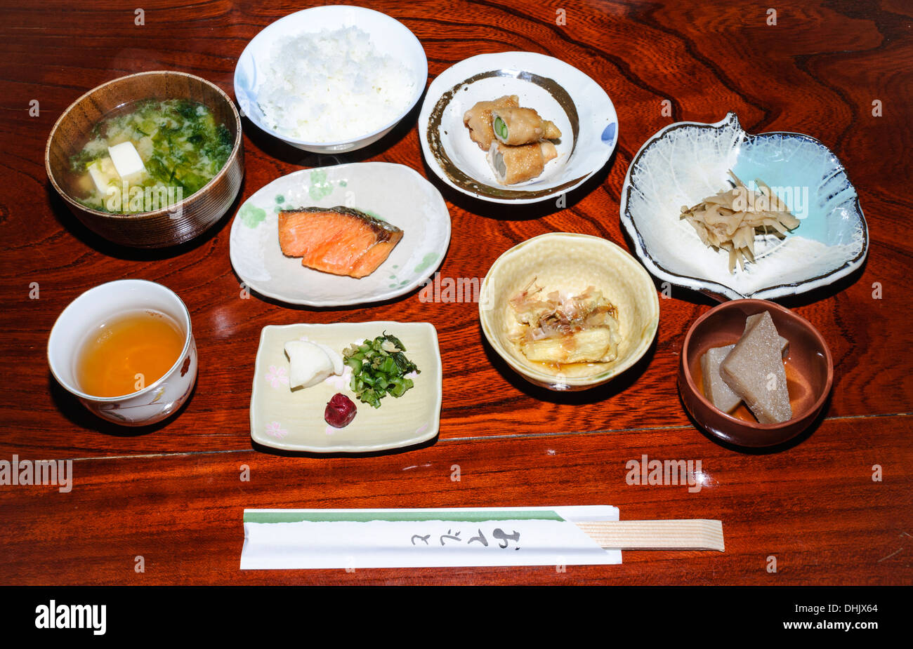 Washoku: Traditional Japanese breakfast meal as served in a ryokan (traditional style inn), with many courses served at once. Japan, food. - Stock Image