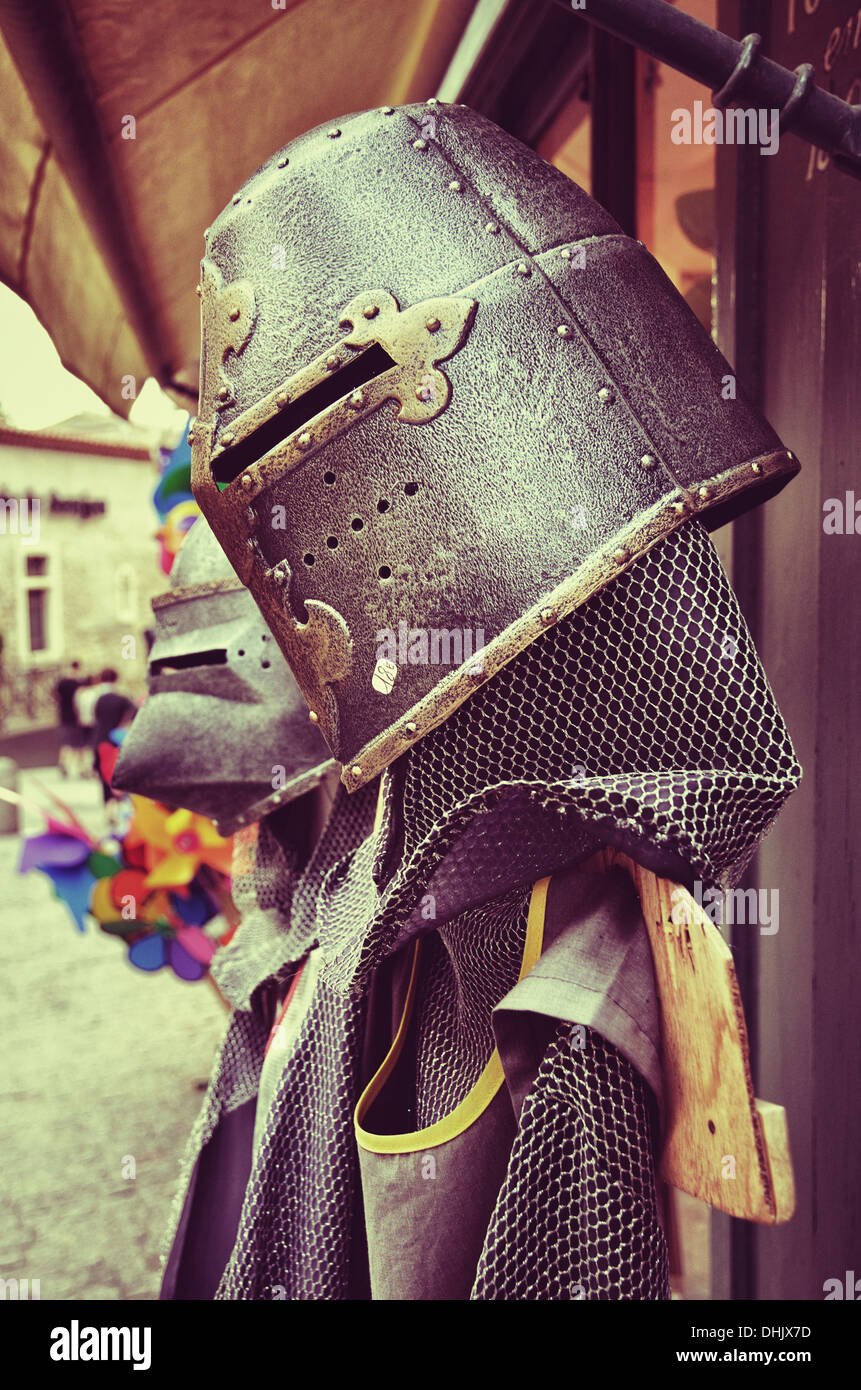 Detail of suits of toy armor for sale in Carcassonne, France. - Stock Image