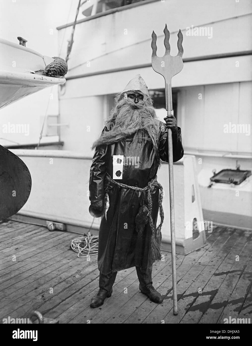 View of a man disguised as Neptune at a party aboard the passenger liner 'Victoria Luise', undated photograph (1912). The image was taken by the German photographer Oswald Lübeck, one of the earliest representatives of travel photography and ship photography aboard passenger ships. Photo: Deutsche Fotothek/Oswald Lübeck - Stock Image