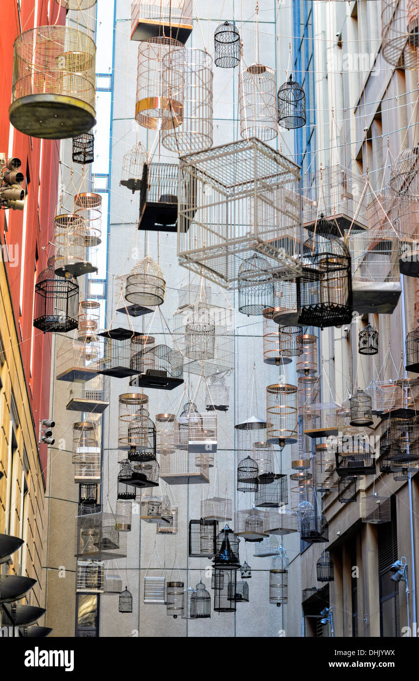 Urban modern art: symbolic artistic installation in a city lane, between buildings - Stock Image