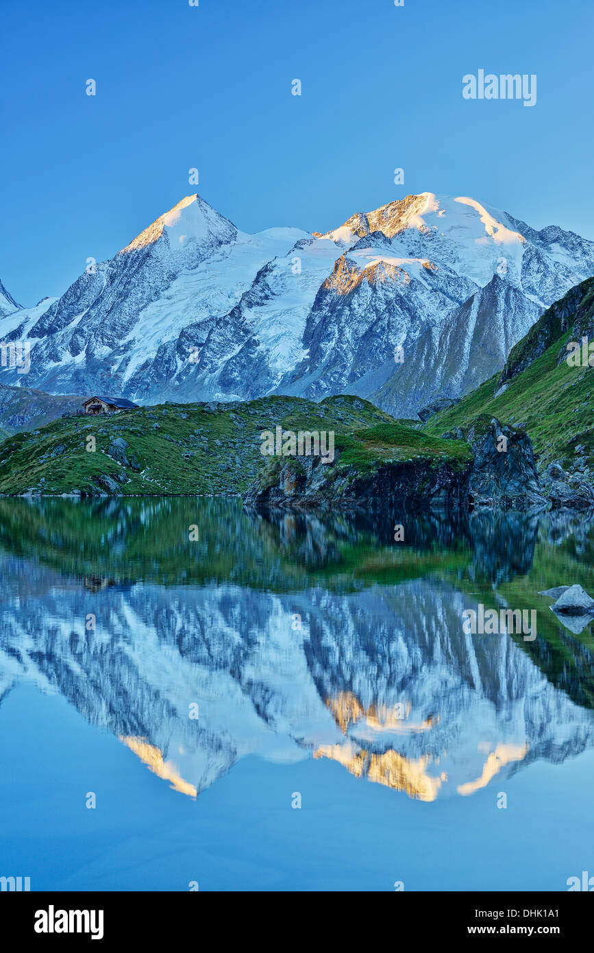 Combin de Corbassiere and Petit Combin reflecting in a mountain lake, Pennine Alps, Valais, Switzerland - Stock Image