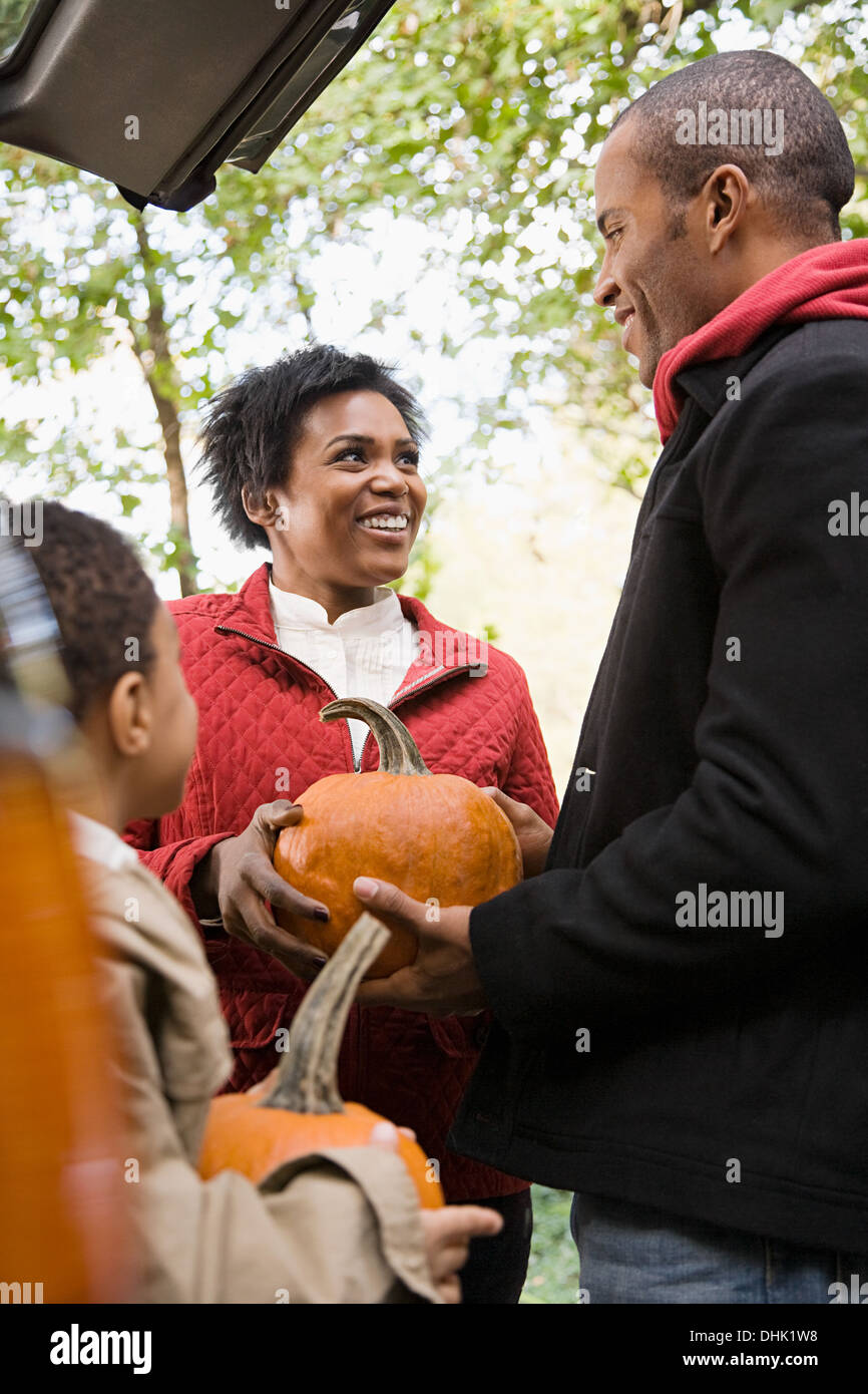 Family with pumpkins - Stock Image