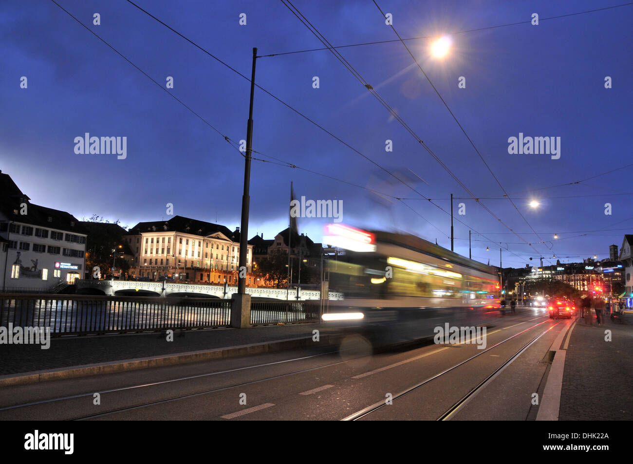 View over Limmat river onto administrative buildings in the evening, Zurich, Switzerland, Europe - Stock Image