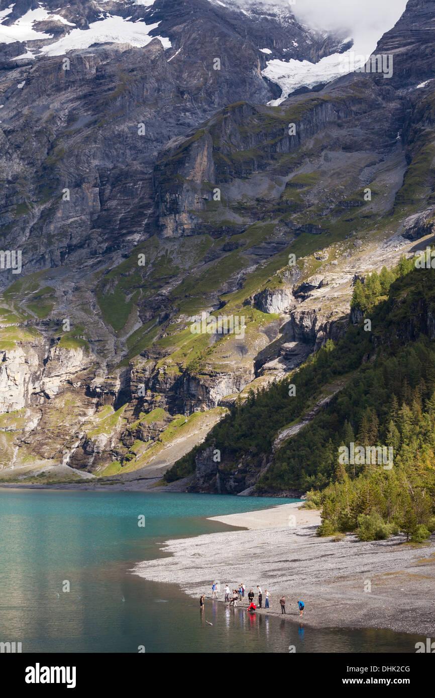 A group of teenagers at lake Oeschinen, Bernese Oberland, Canton of Bern, Switzerland - Stock Image