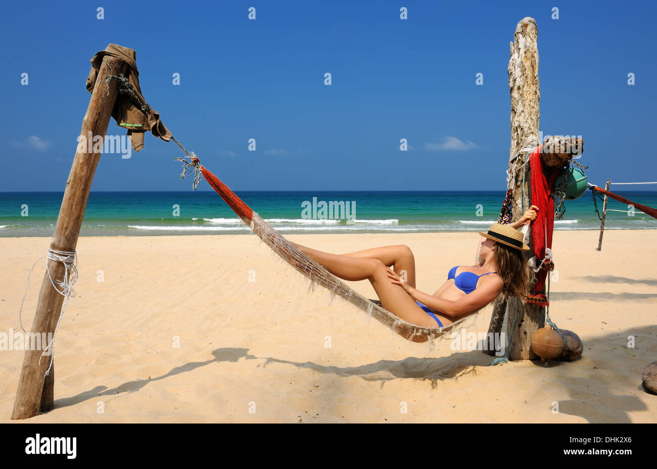 Woman in hammock on beach - Stock Image