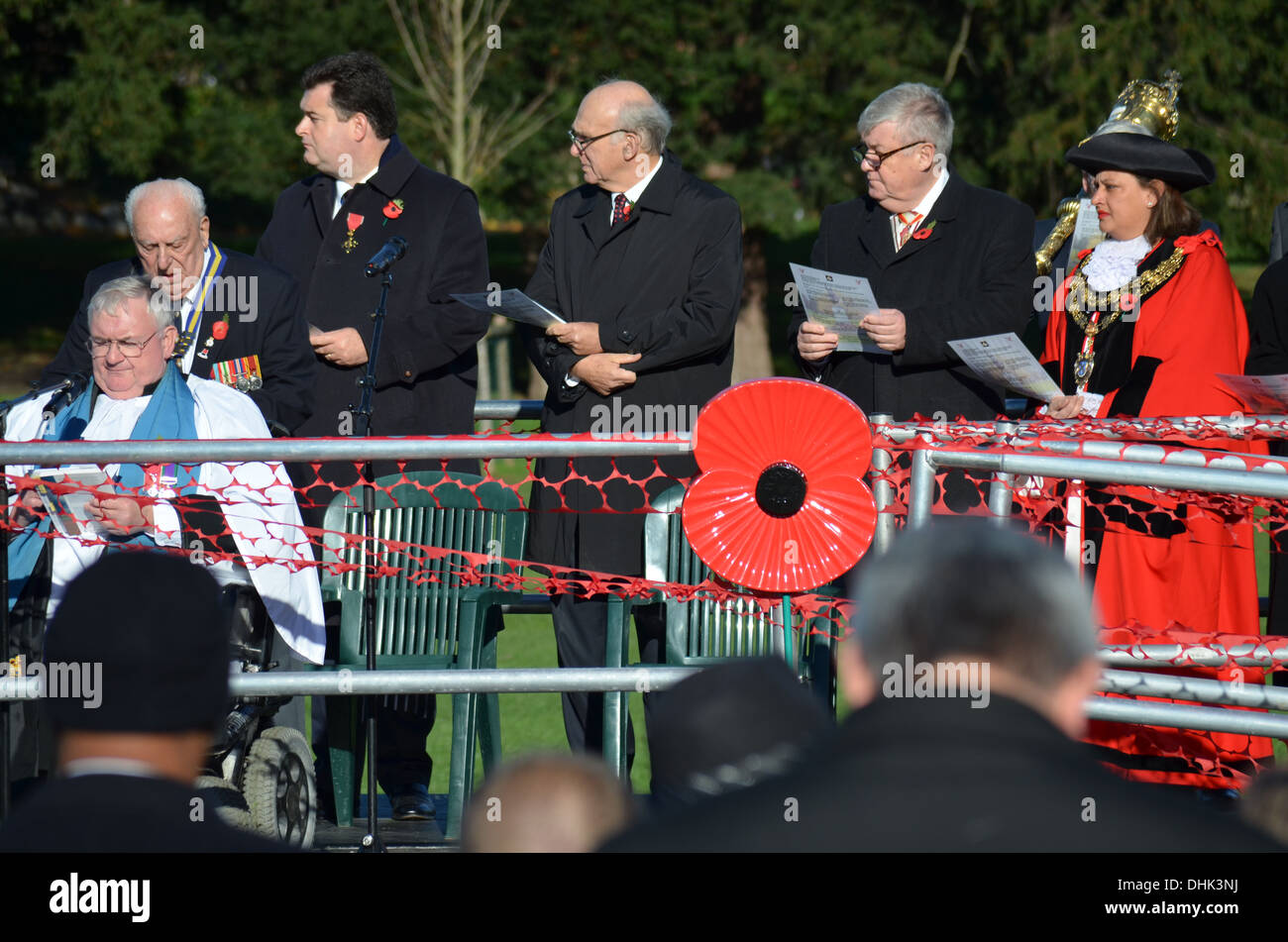 Remembrance Sunday, Nov 11th, Twickenham cenotaph,the Mayoress the M.P.and dignitaries celebrate before the symbol of a poppy. - Stock Image