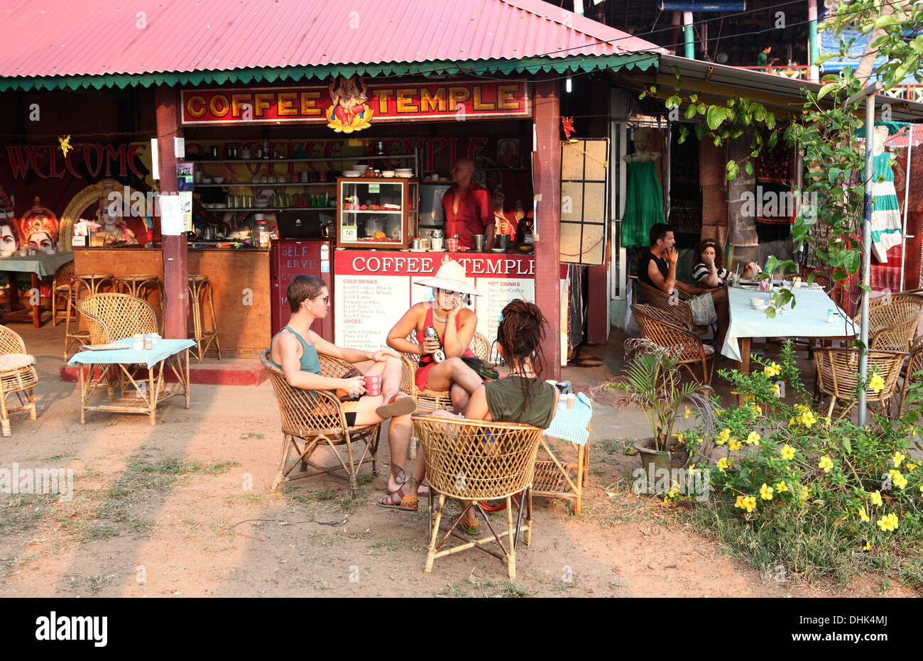 People sitting  outside a coffee shop in Varkala,India. Stock Photo