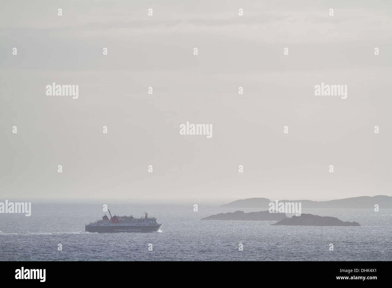 Caledonian MacBrayne (CalMac) ferry sailing between the Summer Isles on its way to Lewis. Stock Photo