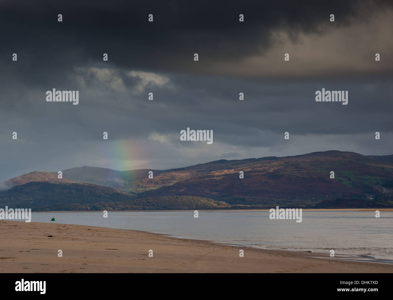 Rainbow in front of Mynydd Du and Foel Goch, as seen from Aberdovey beach at the Dovey/Dyfi estuary, Aberdovey, Stock Photo