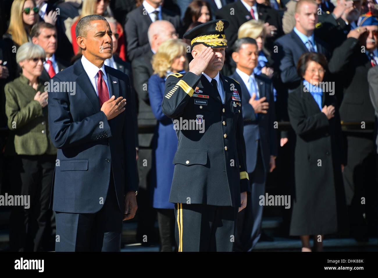 US President Barack Obama and Commanding General, U.S. Army Military District of Washington Maj. Gen. Jeffrey Buchanan during ceremonies to honor veterans at Arlington National Cemetery in honor of Veterans Day November 11, 2013 in Arlington, VA. - Stock Image