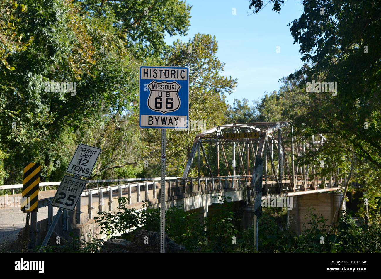 Route 66 road sign by an old truss girder box bridge crosses a river in rural Missouri, USA Stock Photo