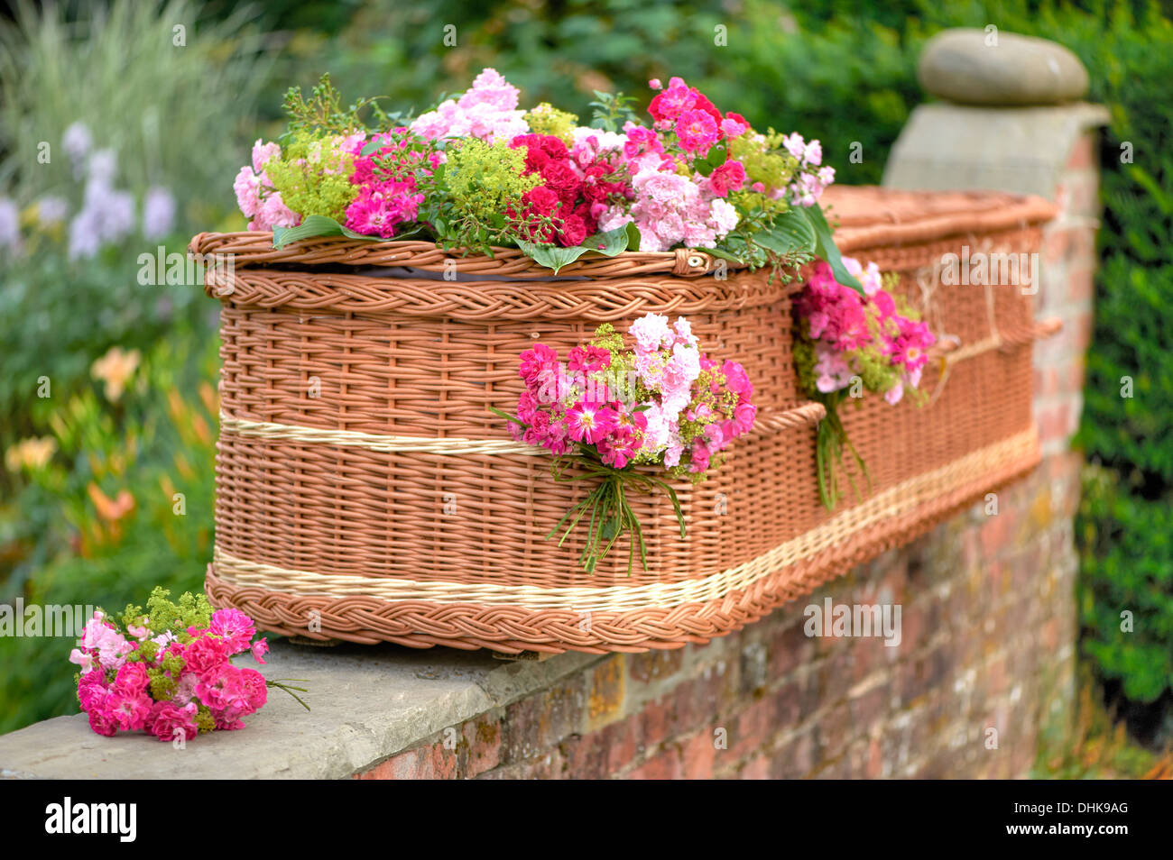 Wicker coffin with flower decoration - Stock Image