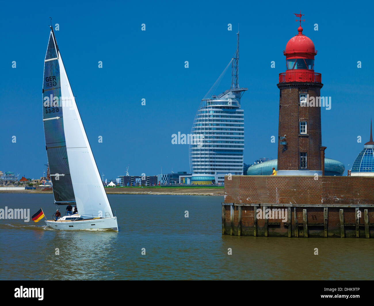 Lighthouse at the Geestemünde with Atlantic Hotel Sail City, Klimahaus and Mediterraneo, Bremerhaven, Bremen, Germany - Stock Image
