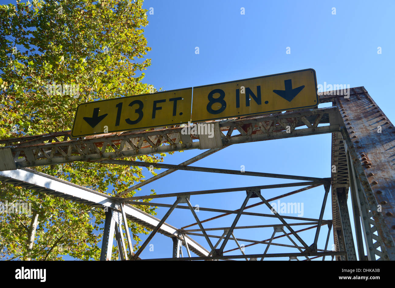 Height restriction sign on old truss girder box bridge crosses a river on old Route 66 in rural Missouri, USA Stock Photo